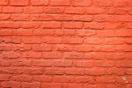 daubed: Background from a brick wall with red plaster Stock Photo