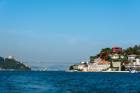 hisari: The Bosphorus in Istanbul with a Houses at the shore and the second Bosphorus Bridge in the distance