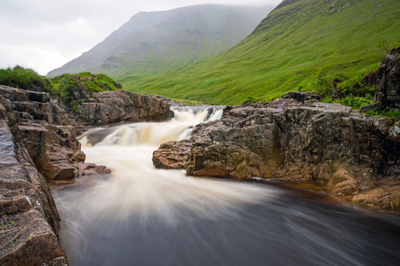 The river Etive in Glen Coe, Scotland, on a rainy day Stock Photo