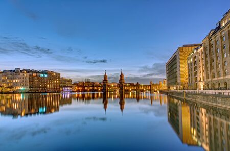 spree: The River Spree with the Oberbaumbruecke in Berlin at dawn