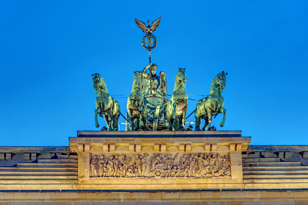 quadriga: Detail of the Quadriga on top of the famous Brandenburg Gate in Berlin at night Stock Photo
