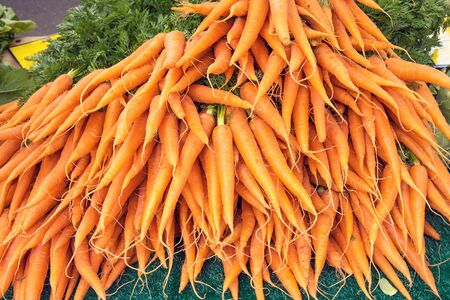 vitamines: A bunch of carrots for sale at a market Stock Photo