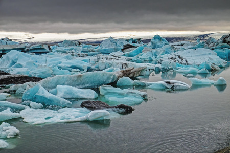 glaciar: The Jokulsarlon glaciar lagoon in Iceland with dark clouds