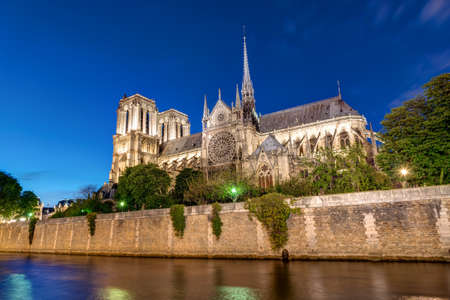 Notre Dame and the River Seine in Paris at night Stock Photo