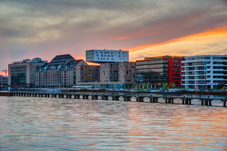 or spree: Sunset at the river Spree in Berlin with modern office buildings at the riverbank Stock Photo