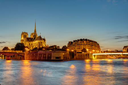 The Ile de la Cite with the famous Notre Dame cathedral in Paris at sunset