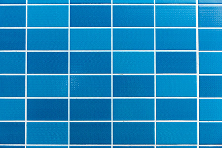 tiles floor: A blue tiled background with Relatively small tiles