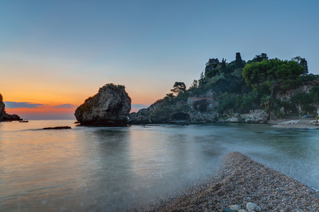 bella: Sunrise at the coast of Taormina in Sicily with the beautiful Isola Bella