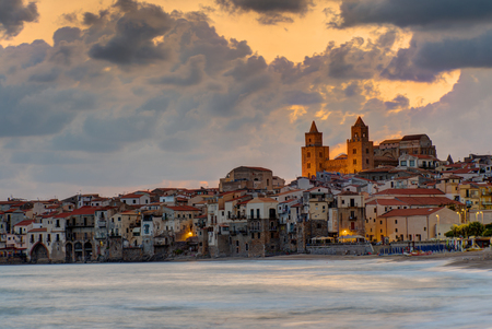 old church: Dramatic sunrise in Cefalu, Sicily, with the Norman cathedral Stock Photo
