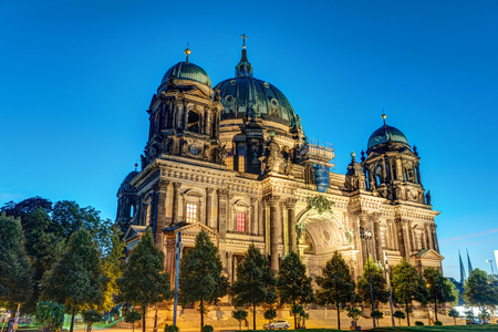 The illuminated Cathedral in Berlin, Germany, in the earl morning Stock Photo