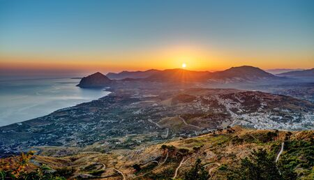 erice: Sunrise seen from Erice in Sicily with the Monte Cofano in the back