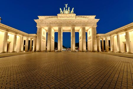 brandenburg gate: The famous Brandenburg Gate in Berlin illuminated at night Stock Photo