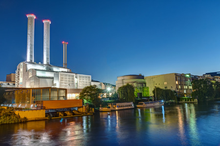 Cogeneration plant at the river Spree in Berlin at night Фото со стока - 71437606