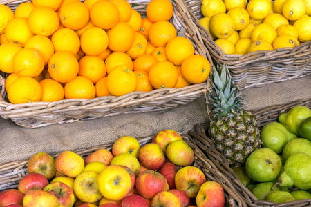 Oranges, apples and pears for sale at a market Stock Photo