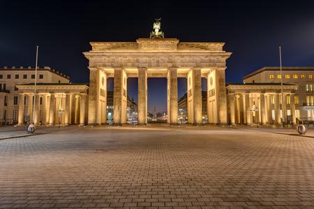 The famous Brandenburg Gate in Berlin illuminated at night Stock Photo