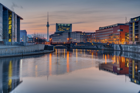 Sunrise at the river Spree in Berlin with the Television Tower in the back Stock Photo