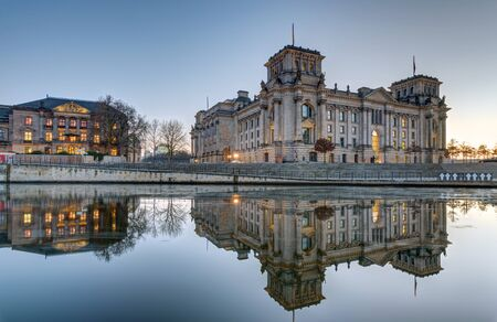 or spree: The Reichstag at the River Spree in Berlin at dusk