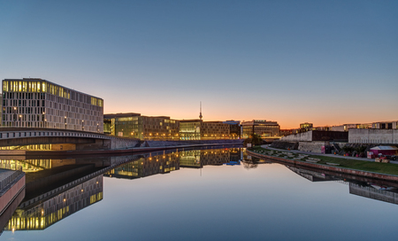 Office buildings at the river Spree in Berlin at dawn with the television tower in the back
