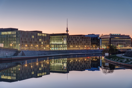 Sunrise at the river Spree in Berlin with the Television tower in the back