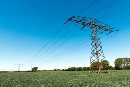 metal grid: Transmission tower with powerlines in Germany