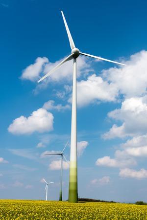 Windwheels in an oilseed rapefield seen in Germany