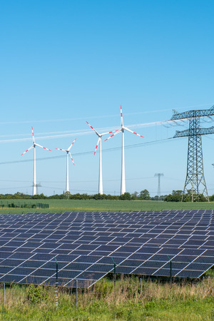 Photovoltaic and wind power with overhead wires seen in Germany Banco de Imagens