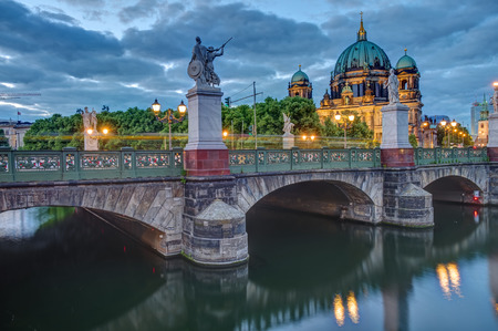 reviews: The Cathedral and the castle bridge in Berlin at dusk