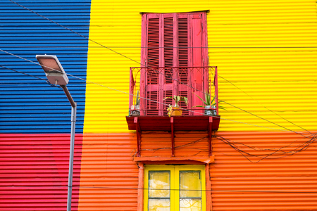 Colorful house in La Boca, Buenos Aires, with balcony and streetlight