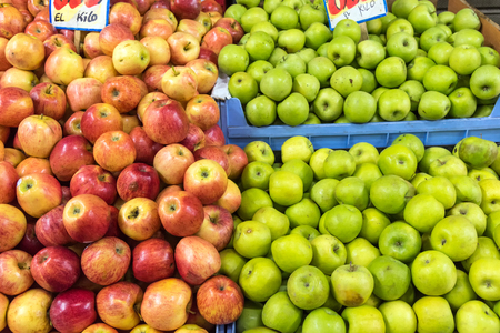 Fresh red and green apples for sale at a market Stock Photo