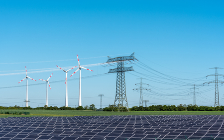 Solar energy panels, wind power and electricity pylons lakes in Germany