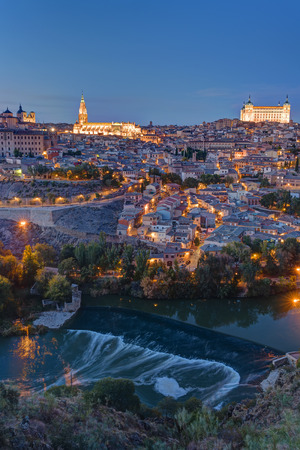 View of Toledo in Spain with the Tagus river at dusk