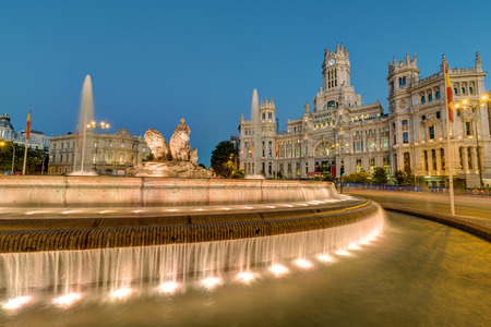 The Plaza de Cibeles with the Palace of Communication and the Cibeles Fountain in Madrid at night Editorial