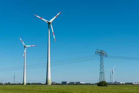 Wind turbines and overhead lines on a sunny day in Germany Stockfoto - 98102516