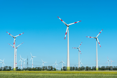 Modern wind turbines on a sunny day in Germany Stock Photo