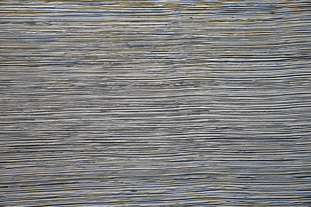 A rough gray background with a horizontal texture