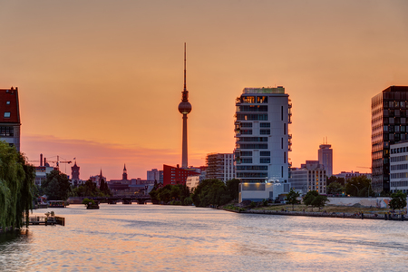 Beautiful orange sky at sunset over Berlin with the famous Television Tower Stock Photo
