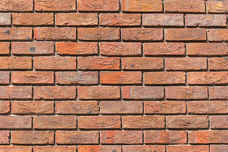 Background from a uniformly red brick wall