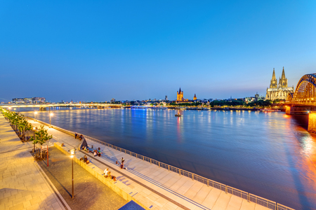 The river banks of the river Rhine in Cologne after sunset