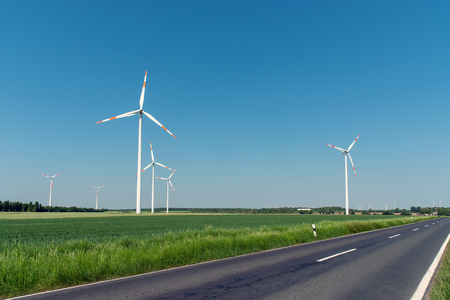 Wind turbines and a country road in Germany Archivio Fotografico