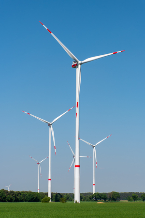 Wind turbines in a rural area lakes in Germany