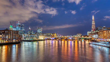 The City of London at the Thames River at night