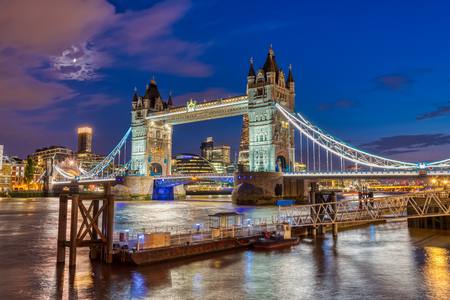 The illuminated Tower Bridge in London, UK, at twilight
