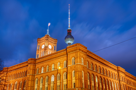 The Berlin City Hall with the famous Television Tower at the back at night Stock Photo