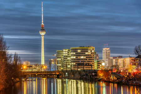 The river Spree, the famous Television Tower and some office buildings in Berlin at night