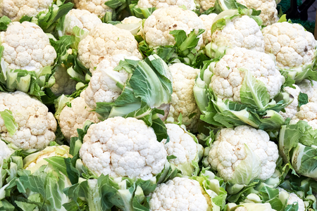 Pile of fresh cauliflowers for sale at a market