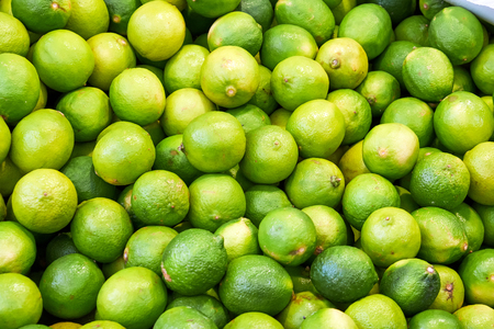 A pile of limes for sale at a market Stock Photo