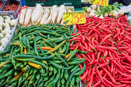 Green and red chilies for sale at a market