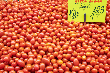 Pile of small tomatoes for sale at a market Stock Photo