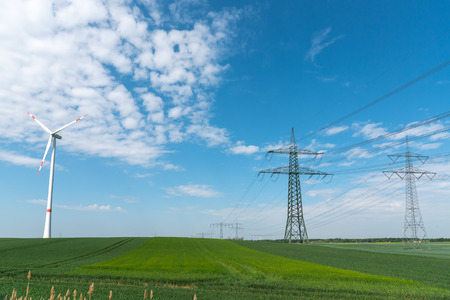 Power lines and a wind turbine lakes in rural Germany