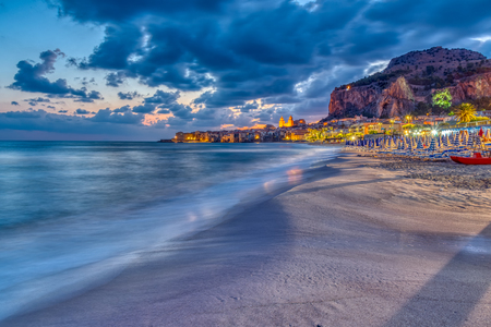 The beach of Cefalu at the north coast of Sicily before sunrise